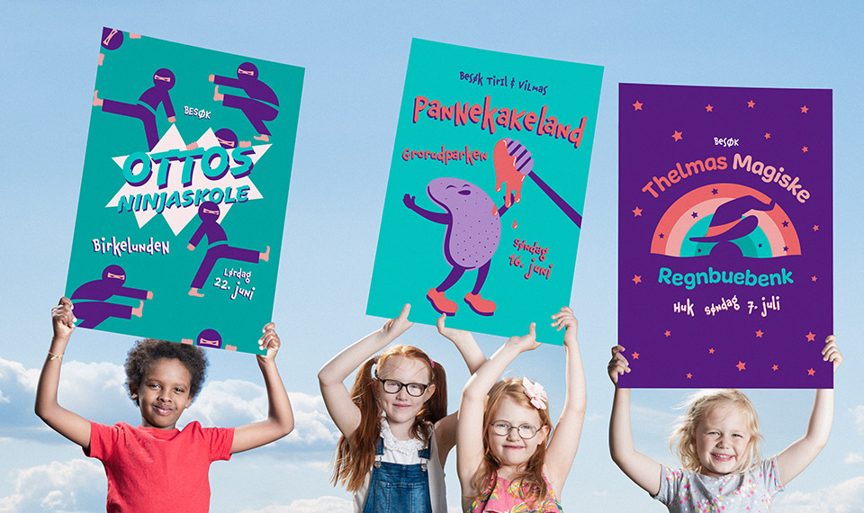 Barn på en rekke som holder opp plakater fra kampanjen.